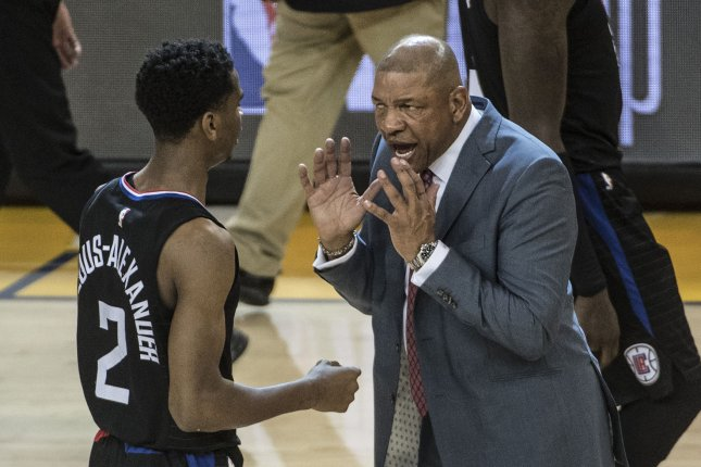 Former Los Angeles Clippers head coach Doc Rivers (R) reached an agreement with the Philadelphia 76ers only three days after the veteran coach left the Clippers. File Photo by Terry Schmitt/UPI