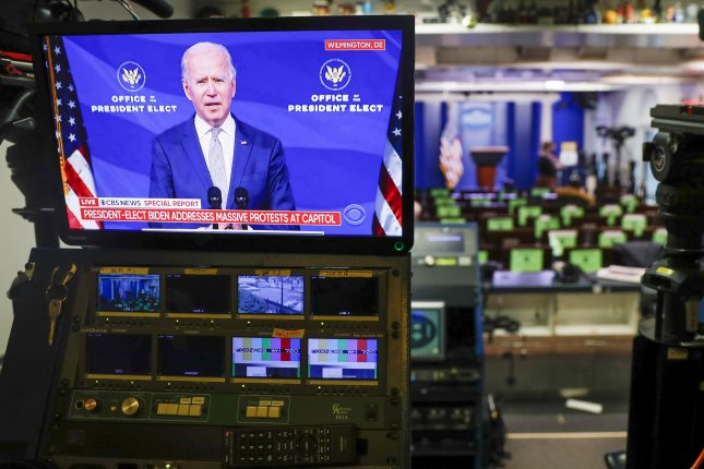 President-elect Joe Biden, seen on a television screen in the Brady press briefing room at the White House, calls on President Donald Trump to end the violence at the U.S. Capitol. UPI Photo