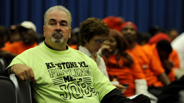 A man supporting the Keystone XL pipeline project watches speakers at a State Department hearing to consider if it is in the U.S. national interest in Washington, DC, on October 7, 2011. The pipeline would carry crude oil from Canada through nine U.S. states to Houston, Texas. UPI/Roger L. Wollenberg