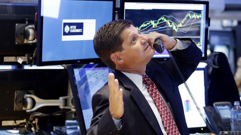 A trader on the floor of the NYSE. UPI/John Angelillo
