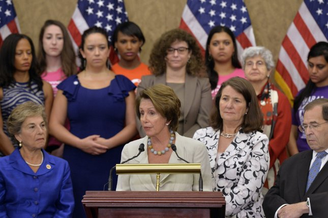 House Minority Leader Nancy Pelosi, D-Calif., (L) speaks on the Not My Boss's Business Act, legislation change the Supreme Court's ruling on women's health in the Hobby Lobby decision, in Washington, D.C. on July 15, 2014. Pelosi was joined by fellow democrats and supporters of women's health rights. UPI/Kevin Dietsch