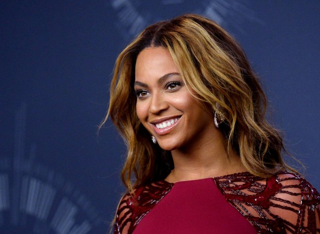 Beyonce sing three teenage girls to her management company, Parkwood Entertainment. File photo by Jim Ruymen