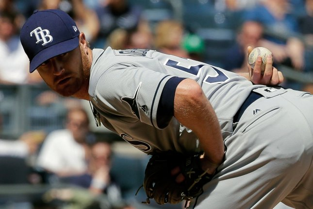 Tampa Bay Rays starting pitcher Alex Cobb checks a runner at first base. File photo by Ray Stubblebine/UPI