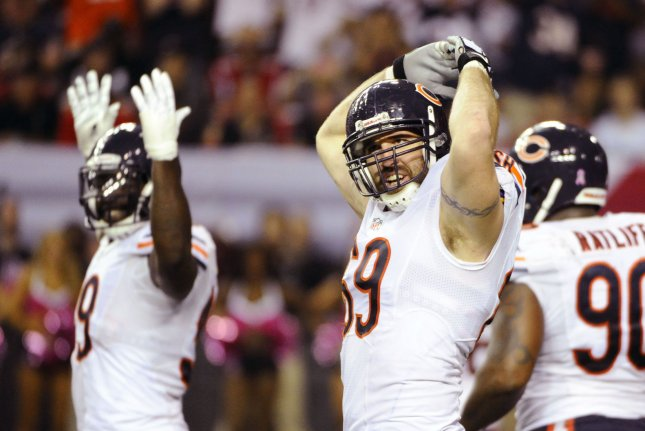 Former Chicago Bears defensive ends Jared Allen (69) and Lamarr Houston (L) celebrate after sacking Atlanta Falcons quarterback Matt Ryan. Photo by David Tulis/UPI