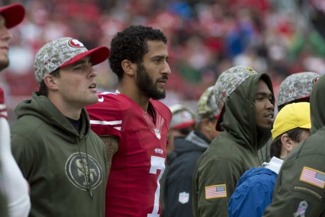 Former San Francisco 49ers quarterback Colin Kaepernick watches on in defeat versus the Atlanta Falcons from the sidelines in the second quarter at Levi's Stadium in Santa Clara, California on November 8, 2015. File photo by Terry Schmitt/UPI