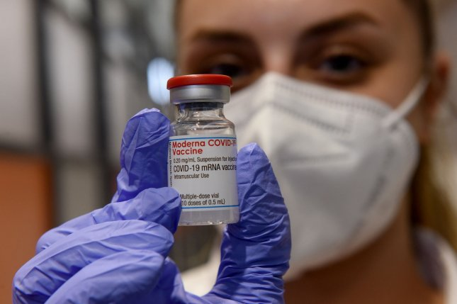 A health worker displays an ampule of Moderna's COVID-19 vaccine at an Israeli vaccination center on March 8. Photo by Debbie Hill/UPI