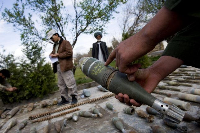 An Afghan security official inspects confiscated ammunition, explosives and arms recovered from the outskirts of Herat, Afghanistan on March 3, 2010. Afghan security forces recovered the cache during an operation against Taliban militants in Herat this week. UPI/Hossein Fatemi