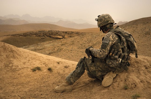 A soldier takes a quick break from walking during a dismounted patrol near Combat Outpost Mizan, Mizan District, Zabul Province, Afghanistan on August 16, 2010. The patrol focused on speaking with the local population to assess their needs and any gather intelligence on insurgent activity in the area. UPI/Nathanael Callon/U.S. Air Force
