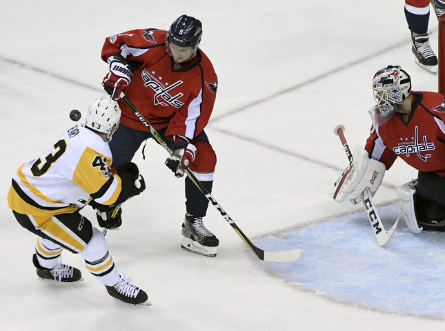 Washington Capitals defenseman Dmitry Orlov blocks the shot of Pittsburgh Penguins left wing Conor Sheary during a Stanley Cup playoff game in May. Photo by Mark Goldman/UPI