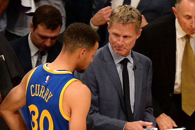 Golden State Warriors head coach Steve Kerr (R) talks to point guard Stephen Curry against the Los Angeles Lakers on November 4, 2016 at Staples Center in Los Angeles. File photo by Jon SooHoo/UPI