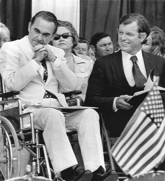 Alabama Gov. George Wallace (L) is seen at an Independence Day rally in Decatur, Ala., on July 4, 1973, about 14 months after he was wounded in an assassination attempt at a Laurel, Md., shopping center on May 15, 1972, during a presidential campaign stop. UPI Photo/File