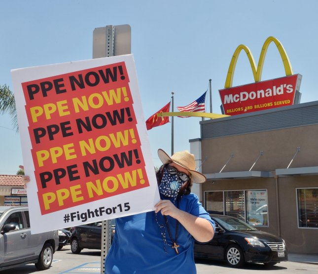 Striking McDonald's workers hold a motor march and protest to call out their employer's alleged failed response to the COVID-19 pandemic in Monterey Park, California on Wednesday. Photo by Jim Ruymen/UPI