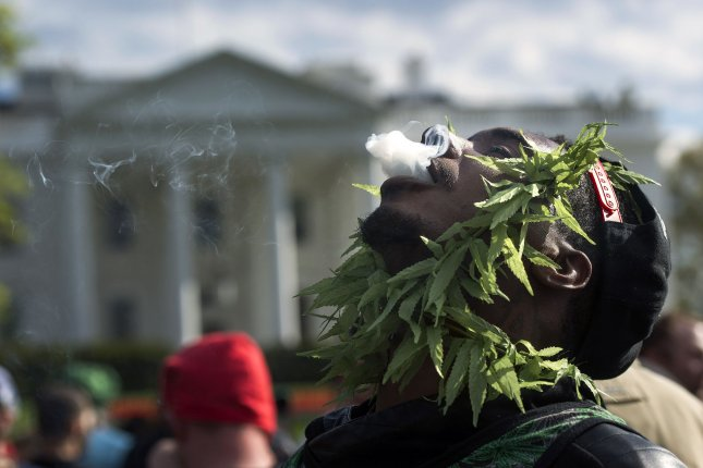 A pro-legalization marijuana activist smokes in front of the White House in Washington, D.C., with other supporters during a protest in 2016 calling for greater access to medical marijuana and decriminalizing pot. File Photo by Kevin Dietsch/UPI