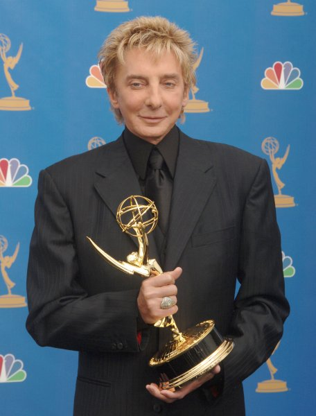 Barry Manilow holds his Emmy for individual performance in a music program at the 58th annual Primetime Emmy awards at the Shrine Auditorium in Los Angeles, California on August 27, 2006. (UPI Photo/Jim Ruymen)