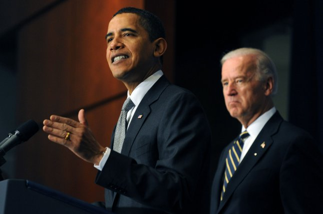 US President Barack Obama (L) and Vice President Joe Biden (R) deliver remarks highlighting the transportation projects and infrastructure jobs created by the Recovery Act at the Department of Transportation in Washington on April 13, 2009. (UPI Photo/Michael Reynolds/POOL)