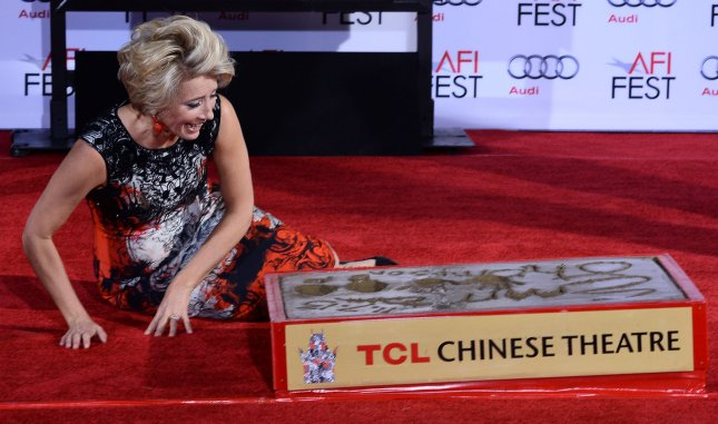 Actress Emma Thompson reacts during a ceremony immortalizing her in the forecourt of TCL Chinese Theatre (formerly Grauman's) in the Hollywood section of Los Angeles on November 7, 2013. UPI/Jim Ruymen