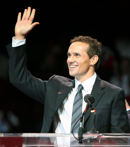 Steve Yzerman waves to the crowd during a jersey retirement ceremony of his number 19 in Detroit Jan. 2, 2007. Yzerman was named to the Hockey Hall of Fame Nov. 9, 2009. (UPI Photo/Scott R. Galvin)