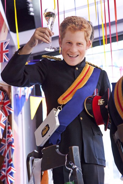 An actor wearing a mask and dressed as Prince Harry performs in a window of a Selfridges department store in London on April 28, 2011. Visitors from around the world are expected to arrive in London this week for the royal wedding of HRH Prince William and Kate Middleton, which will take place on April 29, 2011. UPI/ David Silpa
