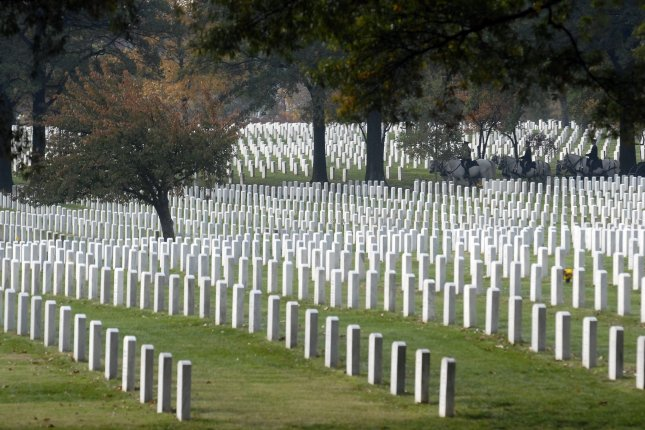 Rows of head stones seen at Arlington National Cemetery. National cemeteries allow same-sex spouses to be buried next to one another, but Idaho State Veterans Cemetary won't. (UPI Photo/Kevin Dietsch)