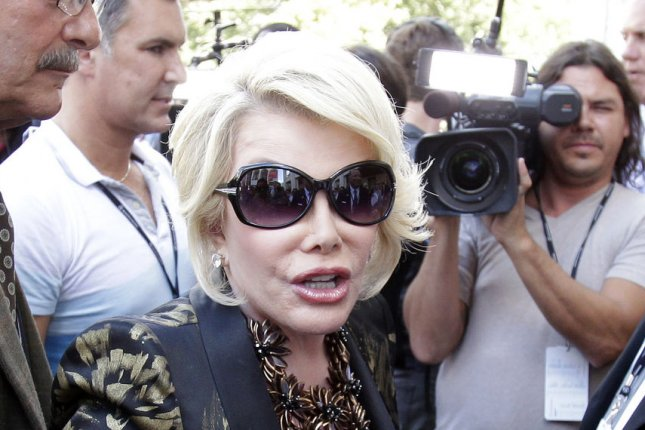 Joan Rivers interviews people outside at the Spring 2014 collections of Mercedes-Benz Fashion Week at Lincoln Center in New York City on September 5, 2013. UPI/John Angelillo