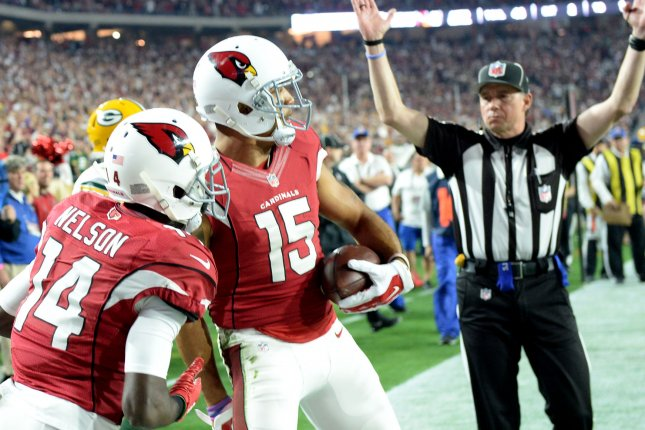 Arizona Cardinals Michael Floyd (R) is congratulated by J.J. Nelson after Floyd's touchdown in the first quarter of the Cardinals-Green Bay Packers game at University of Phoenix Stadium in Glendale, Arizona on January 16, 2016. Photo by Art Foxall/UPI