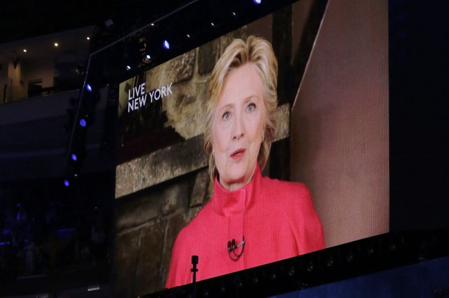Hillary Clinton appears via video feed where she said she wanted to inspire women during day two of the Democratic National Convention at Wells Fargo Center in Philadelphia, Pa. on July 26, 2016. Pitch Perfect producer Elizabeth Banks gathered several actors, singers and other stars to perform an a cappella cover of Rachel Platten's Fight Song in support of Clinton's campaign for president. 