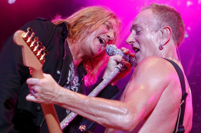 Joe Elliott (L) and Phil Collen (R) with Def Leppard perform in concert at the Cruzan Amphitheater in West Palm Beach, Fla. on June 15, 2011. File Photo by Michael Bush/UPI