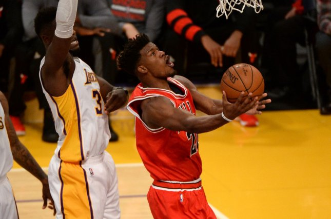Chicago Bulls forward Jimmy Butler (21) scores by Los Angeles Lakers forward Julius Randle (30) at Staples Center in Los Angeles, November 20, 2016. Photo by Jon SooHoo/UPI