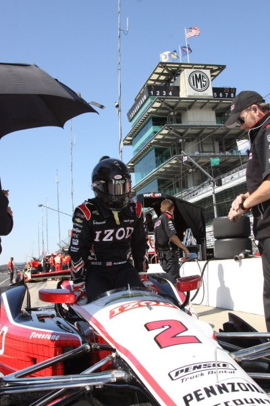 Former NASCAR driver AJ Allmendinger eases into the cockpit of his team Penske racer to begin practice for the Indianapolis 500. Photo by Ed Locke/UPI