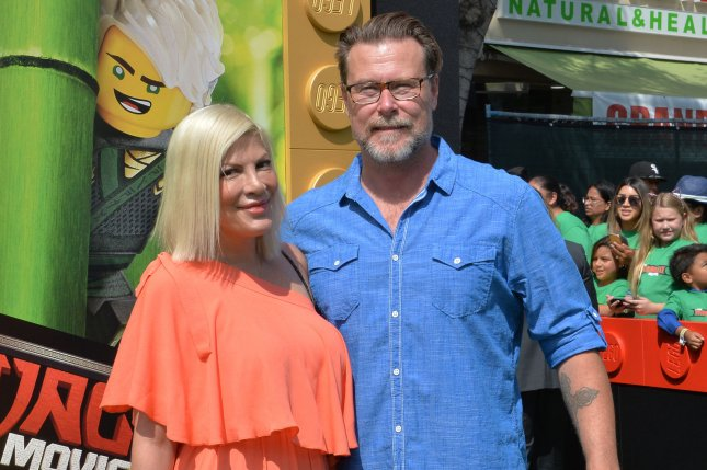 Tori Spelling (L), pictured with Dean McDermott, appeared fine Wednesday before police were called to her home Thursday morning. File Photo by Jim Ruymen/UPI