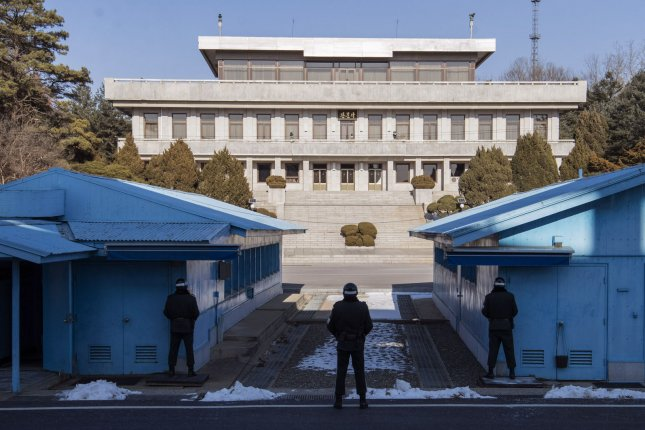 South Korean soldier with the United Nations Command Security Battalion stands guard facing the Panmungak Building on the North Korean side of the Military Demarcation Line (MDL) at the the Joint Security Area (JSA) inside the Demilitarized Zone (DMZ) on the South Korea, North Korea Border on February 6, 2018. Photo by Kevin Dietsch/UPI