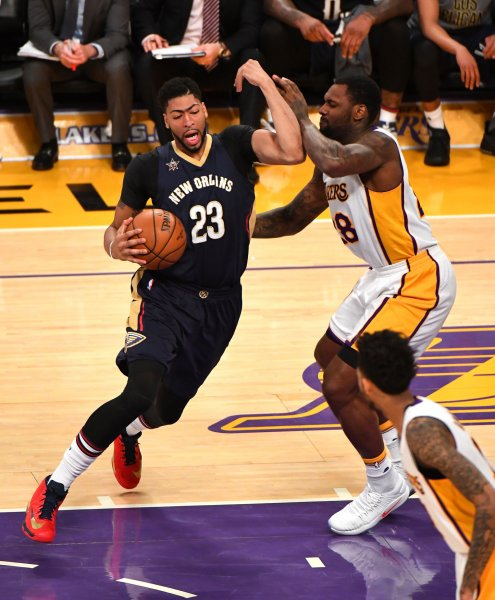 Pelicans forward Anthony Davis (23) fights off Lakers Tarik Black (28) at Staples Center in Los Angeles, March 5, 2017. Photo by Jon SooHoo/UPI