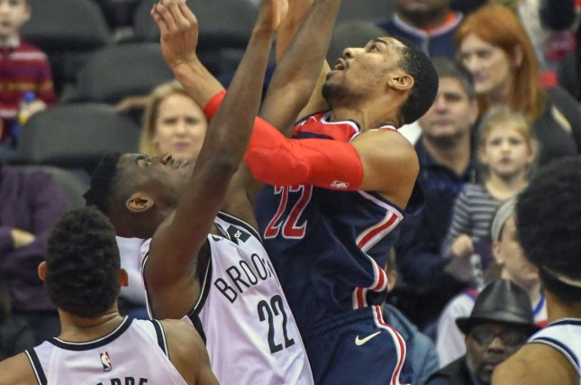 Washington Wizards forward Otto Porter Jr. (22) scores and is fouled by Brooklyn Nets guard Caris LeVert (22) in the first half on January 13 at Capital One Arena in Washington, D.C. Photo by Mark Goldman/UPI