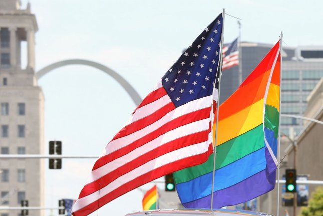 The American flag and Pride flag fly while upon a float during the St. Louis Pride Parade in St. Louis on on June 30, 2019. On Friday the Pentagon announced that it would keep in place a policy prohibiting display of the Pride flag on military installations. Photo by Bill Greenblatt/UPI