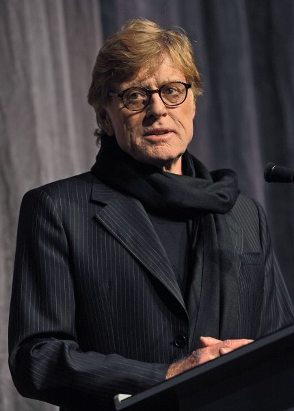 Director and actor Robert Redford goes onstage to introduce the cast before the world premiere screening of 'The Conspirator' at Roy Thomson Hall during the Toronto International Film Festival in Toronto, Canada on September 11, 2010. UPI/Christine Chew