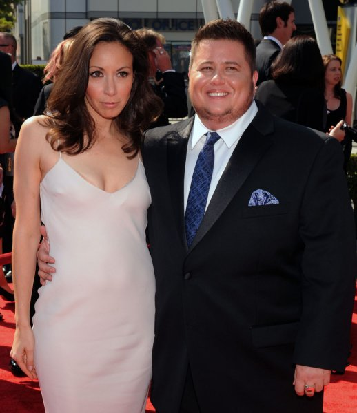 Chaz Bono (R) and his longtime girlfriend Jenniger Elia arrive for the Primetime Creative Arts Emmy Awards at the Nokia Theatre in Los Angeles on September 10, 2011. UPI/Jim Ruymen