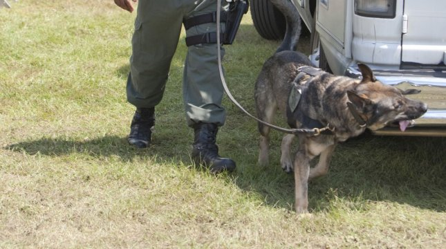 Deputy Kelly, with the St. Johns County Sheriff's Department and his K9 Kwell search media vehicles at the Dove World Outreach Center in Gainesville, Florida September 11, 2010. UPI/Mark Wallheiser