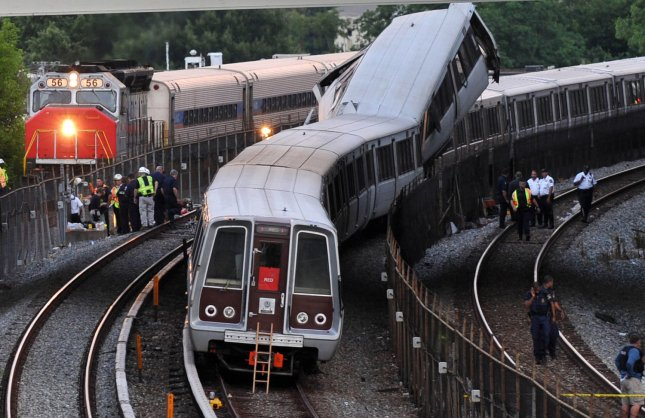 A MARC passenger train passes by the scene of a Metro train accident just outside the Fort Totten Metro station in Washington on June 22, 2009. A metro train crashed into the back of another stopped train. Nine passengers are confirmed dead and over 70 injured. (UPI Photo/Kevin Dietsch)