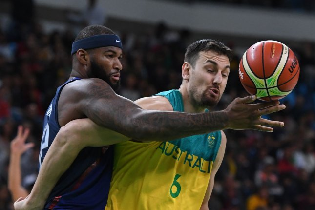 USA' s DeMarcus Cousins reaches over Australia's Andrew Bogut in Basketball at the 2016 Rio Summer Olympics in Rio de Janeiro, Brazil, August 10, 2016. The USA defeated Australia 98-88. Photo by Terry Schmitt/UPI