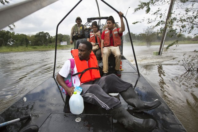 U.S Border Patrol riverine agents evacuate residents from a flooded neighborhood of Houston, Texas, in the aftermath of Hurricane Harvey on August 30, 2017. Photo by Glenn Fawcett/U.S. Customs and Border Protection/UPI