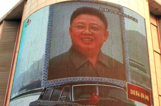 China's state television shows footage of Kim Jong Il's state funeral December 29, 2011. On October 8, 1997, Kim officially inherited his father's title of general secretary of the Communist Party. File Photo by Stephen Shaver/UPI