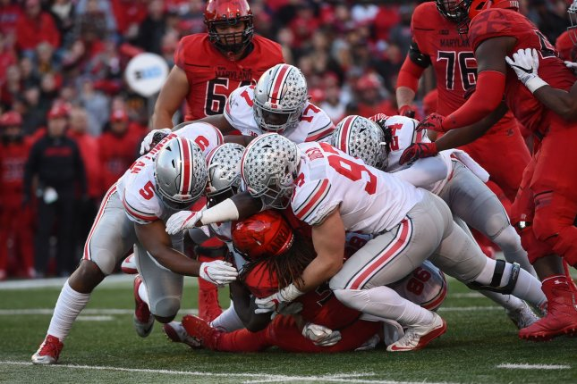 Ohio State Buckeyes linebacker Raekwon McMillan (5), linebacker Jerome Baker (17), Malik Hooker (24) and defensive end Nick Bosa (97) tackle Maryland Terrapins running back Kenneth Goins Jr. (30) during first quarter of their game in College Park, Maryland, November 12, 2016. Photo by Molly Riley/UPI