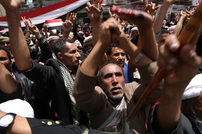 Yemeni anti-regime protesters shout during a rally calling for the ouster of President Ali Abdullah Saleh in Sanaa on April 5, 2011, as two dissident soldiers and three other people were killed in a firefight between troops and tribesmen close to President Ali Abdullah Saleh. The Yemeni air force bombed tribesmen fighting to overthrow the president.. UPI\Mohammad Abdullah...