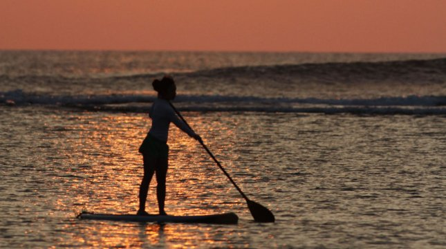 A lone paddle boarder fronts the warm winter glow of the sunset offshore Ala Moana Beach park in Honolulu, Hawaii on January 4, 2012. UPI/Cory Lum
