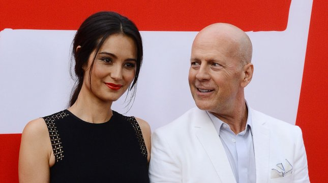 Cast member Bruce Willis and his wife Emma Heming attend the premiere of Red 2 at the Westwood Village Theatre in the Westwood section of Los Angeles on July 11, 2013. In this sequel, retired black-ops CIA agent Frank Moses reunites his unlikely team of elite operatives for a global quest to track down a missing portable nuclear device. UPI/Jim Ruymen