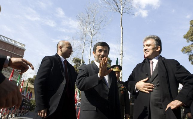 Iranian President Mahmoud Ahmadinejad (L) speaks to media as Turkish President Abdullah Gul stands next to him during an official farewell ceremony in Tehran, Iran on February 15, 2011. UPI/Maryam Rahmanian