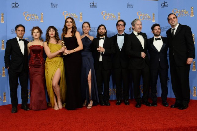 From left, actors Gael Garcia Bernal, Bernadette Peters, Lola Kirke, Saffron Burrows, Jason Schwartzman, and the team from Mozart in the Jungle, winners of the award for Best Television Series -- Musical or Comedy, appear backstage during the 73rd annual Golden Globe Awards in Beverly Hills on January 10, 2016. File Photo by Jim Ruymen/UPI