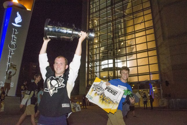 Fans celebrate the Pittsburgh Penguins 2-0 win over the Nashville Predators for the Stanley Cup as they stream out of PPG Paints Arena on June 11, 2017 in Pittsburgh. Photo by Archie Carpenter/UPI