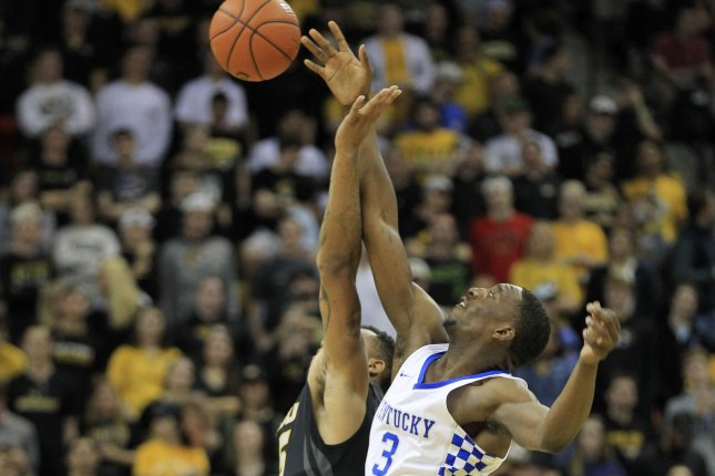 Former Kentucky Wildcats freshman Bam Adebayo out jumps Missouri Tigers' Russell Woods to start the game in 2017 at the Mizzou Arena in Columbia, Miss, Photo by Bill Greenblatt/UPI