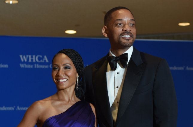 Jada Pinkett Smith (L), pictured with Will Smith, voiced her admiration for the actor prior to his stunt over the Grand Canyon on his 50th birthday. File Photo by Molly Riley/UPI